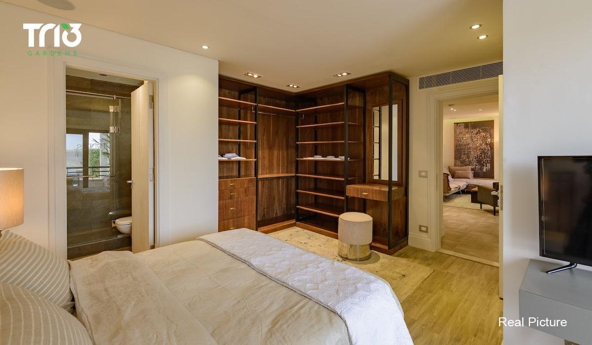 غرفة نوم بشقة في جاردنز تريو القاهرة الجديدة _ يوفن UVISNE